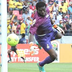 Ghana goalkeeper Fatau Dauda watches the ball hit the post Saturday. (Photo: Stephane De Sakutin/AFP/Getty Images)