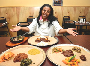 At Mariam's Ethiopian restaurant co-owner Beleteshachew Mulata sits with several of her culinary creations. (DONNA FISHER /