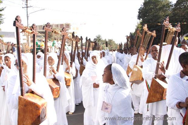 Ethiopian Orthodox Church Choir members playing the Begena (Photo:thereporterethiopia.com)
