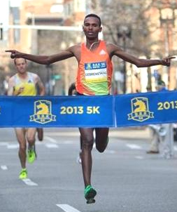 Dejen Gebremeskel, of Ethiopia, won the men's race in the Boston Athletic Association 5K on Sunday morning. (Photo: DINA RUDICK/GLOBE STAFF)