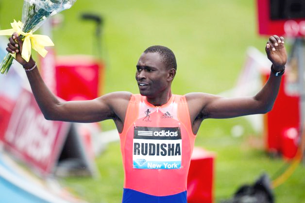 David Rudisha, representing Kenya, celebrates winning the Men's 800m during the IAAF Diamond League Grand Prix competition on Randall's Island, Saturday, May 25, 2013, in New York. Photo: John Minchillo