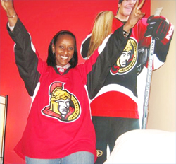 Lily Kassahoun, a former Ottawa resident and ByWard Market restaurant manager who recently opened a restaurant in Addis Ababa called Oh Canada, whose Canuck theme runs throughout the space and where hockey is front and centre. (Photo: ottawacitizen.com)