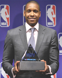 The Nuggets' Masai Ujiri receives the award for 2012-13 NBA executive of the year Thursday at the Pepsi Center. (Hyoung Chang, The Denver Post)