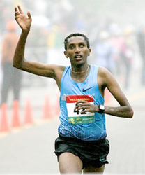 Bazu Worku of Addis Ababa, Ethiopia celebrates as he approaches the finish line at Grandma's Marathon in Duluth, Minn. Saturday June 22, 2013. Worku won the race with a time of 2:11:14 (Clint Austin / caustin@duluthnews.com)