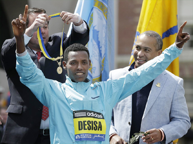 Lelisa Desisa of Ethiopia reacts during the finish line ceremony after winning the men's division of the 2013 Boston Marathon in Boston Monday, April 15, 2013. (AP Photo/Elise Amendola) 1 / 15The Associated Press | Photo By Elise Amendola Share to FacebookShare to TwitterShare to Pinterest ClosePrevious imageNext image