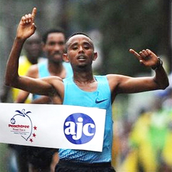 Mosinet Geremew, of Ethiopia, holds up his arms after winning the AJC Peachtree Road Race, Thursday, July 4, 2013 at Piedmont Park, in Atlanta. Up to 60,000 runners ran or walked in the rain to complete the 10K race. (AP Photo/Atlanta Journal-Constitution, Johnny Crawford) Read more: RN-T.com - Thousands run Peachtree Road Race in the rain