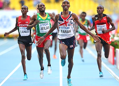 Mo Farah crosses the line to win gold in the men's 10,000 metres final at Moscow. Photograph: Julian Finney/Getty Images