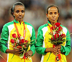 Tirunesh Dibaba (left) and Meseret Defar