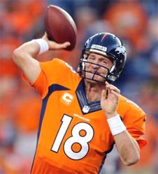 Manning's 7 TDs lead Broncos past Ravens 49-27