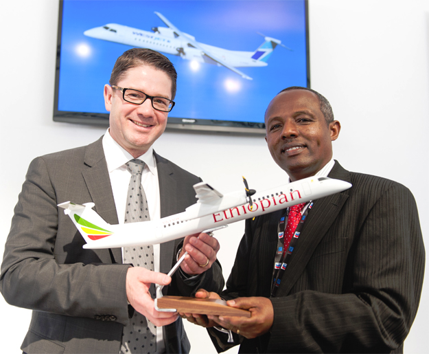 Éric Martel, President, Bombardier Customer Services and Specialized & Amphibious Aircraft (left) and Mr. Mesfin Tasew, Chief Operating Officer, Ethiopian Airlines, celebrate the airline being added to Bombardier's Authorized Service Facility Network. (Photo: bombardier.com)