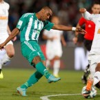 Raja Casablanca's Mouhssine Iajour scores his side's opening goal during the semi final soccer match between Raja Casablanca and Atletico Mineiro at the Club World Cup soccer tournament in Marrakech, Morocco, Wednesday, Dec. 18, 2013. Photo: Matthias Schrader, AP