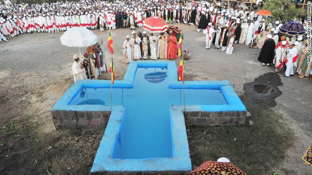 Timket is celebrated slightly differently in each region of Ethiopia, depending on access to water. If it's not possible to immerse oneself, it is acceptable to get sprinkled with water. (Photo: Carl de Souza, Getty Images)