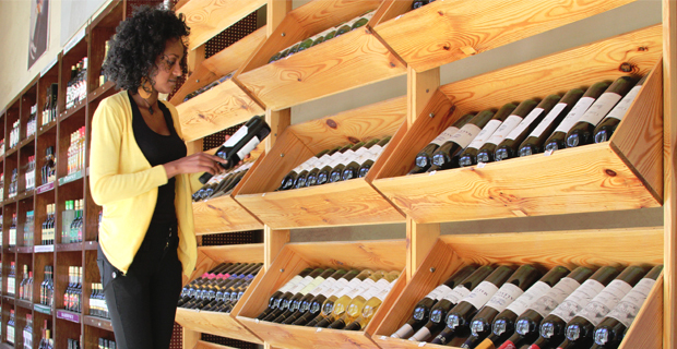 Hewan Woldegebriel, sales person of Country Trading, arranging her wine collection for the holiday market at the upscale liquor store of the company around Piazza in Arada district (photo: Addis Fortune)