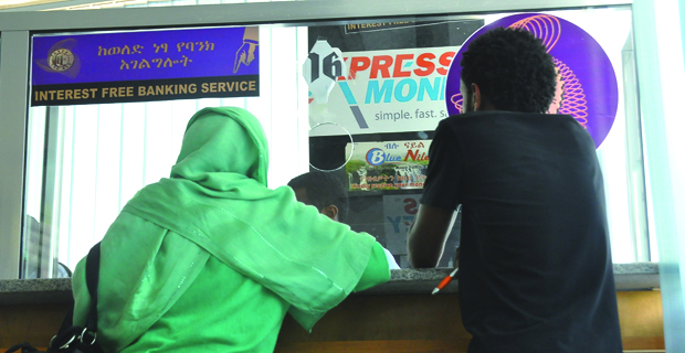 Customers of interest-free banking at the designated window for the service in the Abacoran branch of the Commercial Bank of Ethiopia, in the Addis Ketema District. (Photo: Addis Tribune) -