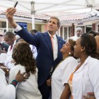 "U.S. Secretary of State John Kerry takes a ""selfie"" with nurses and workers during a visit to the Gandhi Memorial Hospital in Addis Ababa May 1, (photo: ca.finance.yahoo.com) -"