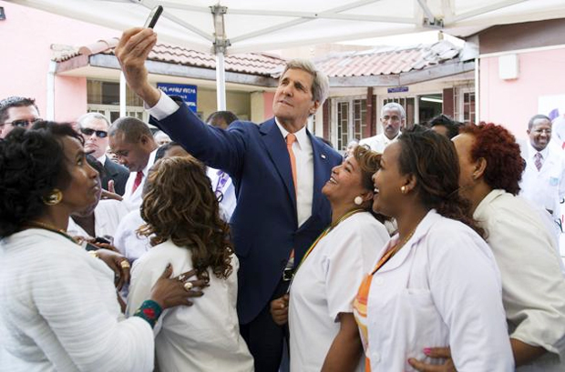 """U.S. Secretary of State John Kerry takes a """"selfie"""" with nurses and workers during a visit to the Gandhi Memorial Hospital in Addis Ababa May 1, (photo: ca.finance.yahoo.com) -"""