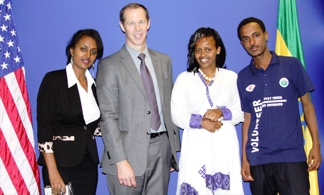 Public Affairs Officer Robert Post (second from left) with winning students (left to right): Feven Abreham, Etsubdink Hailu and Endalekachew Abebe. (Photo: U.S. Embassy) -