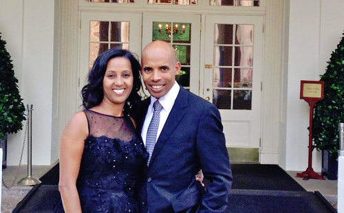 Meb Keflezighi and his wife, Yordanos Asgedom, pose outside the White House. -