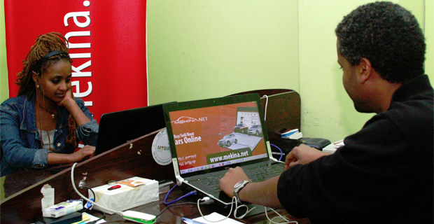 Araya Lakew of Mekina.net and co-worker handling daily operations in Getu Building head office. (photo: Addis Fortune)