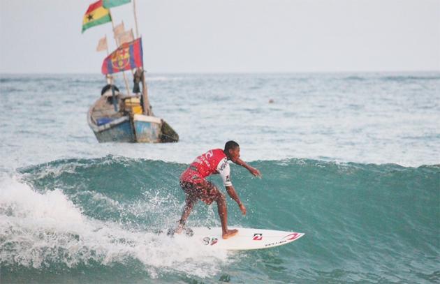 A surfer shreds along a wave at Busua beach -Photograph: Julia Overas/Black Star Surf Shop -