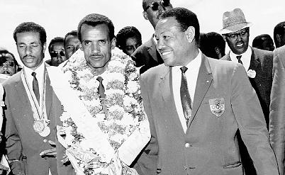 Yidnekachew with Olympic legends Abebe Bikila (left) and Mamo Wolde (center) in 1968.