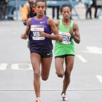 Buzunesh Deba, left, with Tigist Tufa, was second in the 2013 New York City Marathon, months after her friend Meskerem Legesse died. Credit Michelle V. Agins/The New York Times -