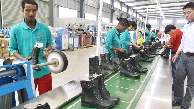 People working on the assembly line in April 2012 at Huajian shoe factory in Dukem, Ethiopia (photo: Jenny Vaughan/AFP/Getty Images) -