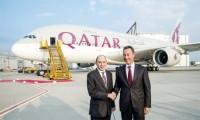 Airbus CEO Fabrice Bregier handing over Qatar Airway's first A380 to Akbar Al Baker, CEO of Qatar Airways