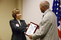 Rep. Suzanne Bonamici presented Taye Yemeru with the FAA's Charles Taylor Master Mechanic Award, which honors selected senior mechanics who have worked in aviation maintenance for at least 50 years, in a surprise ceremony earlier this month.(Hannah Leone/The Oregonian) -