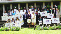 Ambassador Patricia Haslach and First Lady Roman Tesfaye with the award winners.