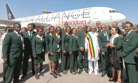 GabreMariam (in national attire) lines up with crew members to celebrate a Star Alliance innovation