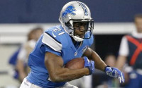 Detroit Lions running back Reggie Bush (21) carries the ball during the first half of an NFL wildcard playoff football game against the Dallas Cowboys, Sunday, Jan. 4, 2015, in Arlington, Texas. (AP Photo/Tony Gutierrez) -
