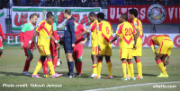 (Saint George players protest Tunisian referee Nasrallah Jawadi's decision to award a penalty kick. (Photo Credit: Yakoub Jamous) -
