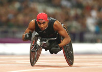 Walid Ktila of Tunisia wins gold in the men's 200m T34 final on day 6 of the London 2012 Paralympic Games © • Getty Images -