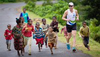 Daren Wendell with the children of Borena (Photo credit: RunDarenRun.com) -