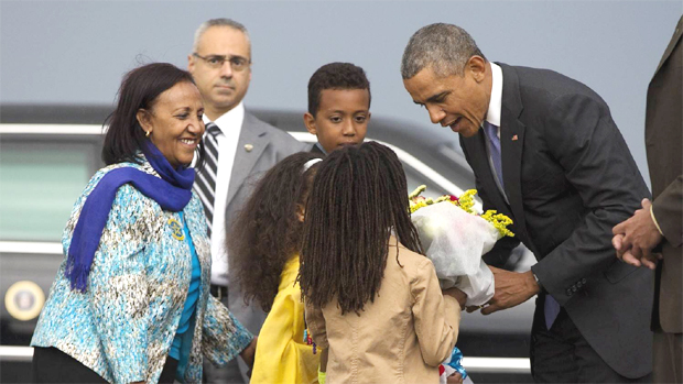 President Barack Obama received flowers upon arrival at Addis Ababa Bole Airport