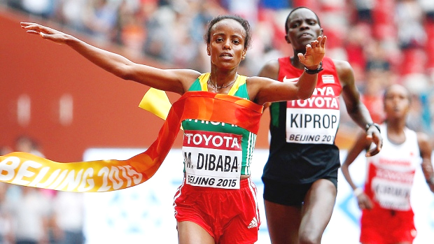 Mare Dibaba of Ethiopia crosses the finish line to win gold in the women's marathon final during Day 9 of the IAAF world track and field championships in Beijing on Sunday. It marked the first women's marathon title for Ethiopia. Dibaba finished in two hours 27 minutes 35 seconds in Beijing, but needed to pick up the pace after entering the stadium to beat two-time champion Helah Kiprop, who finished one second behind. (Christian Petersen/Getty Images for IAAF)