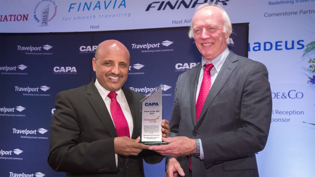 Ethiopian CEO Tewolde GebreMariam accepted the award from CAPA Executive Chairman Peter Harbison (crediT CAPA)