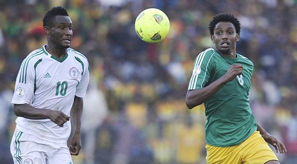 Asrat Megersa (right) battling with John Obi Mikel of Nigeria