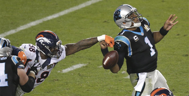 Von Miller strips the ball from Cam Newton during the second half. (AP)