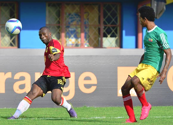 Tekalign Dejene (right) here seen with Angola was 1 of 6 players tried for left back position (Photo: botswanapremierleague.com)