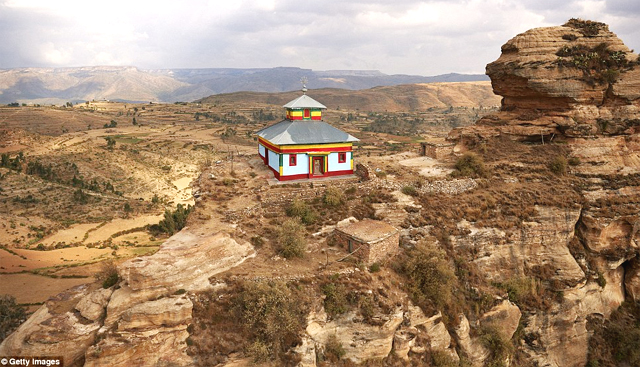 Higher calling: A Christian church in rocky Northern Ethiopia stands out against the rocky landscape with its bright colours (photo: Getty Images)