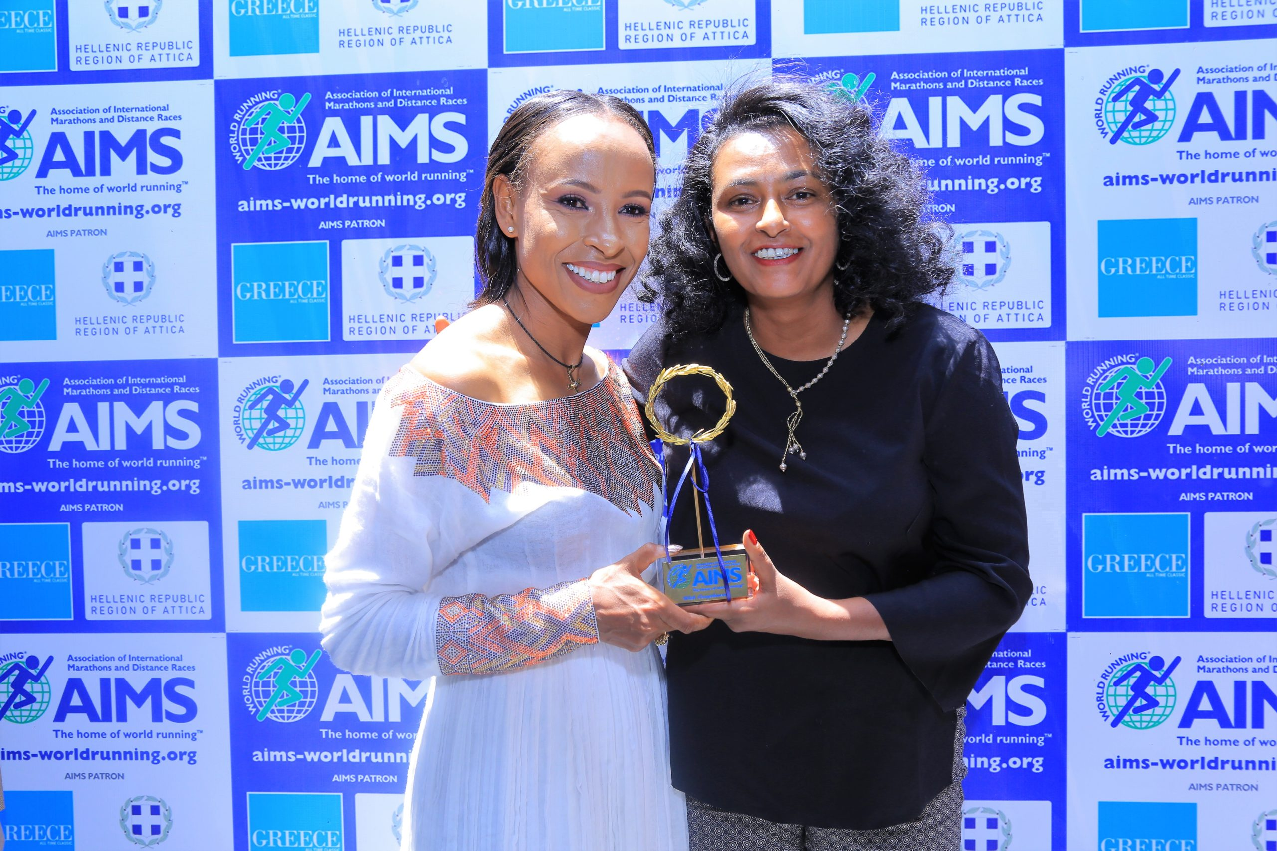 Two-time Ethiopian Olympic Gold Medallist Meseret Defar is presented with the AIMS Inspirational Woman Award